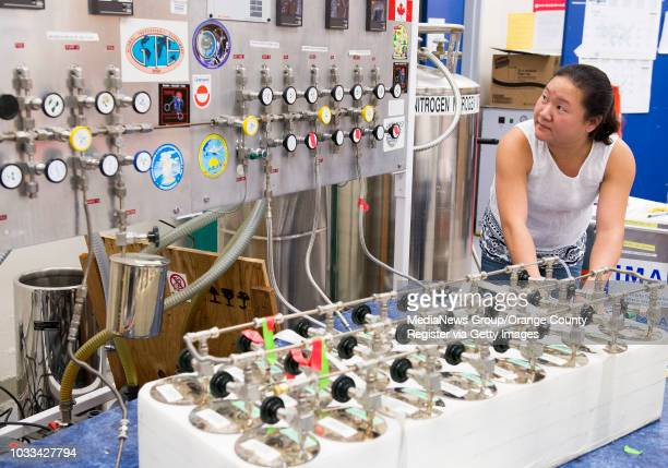 Gloria Liu Weitz a UCI lab analyst with Professor Donald Blake transfers air samples collected for the Atmospheric Tomography Mission in Irvine on...