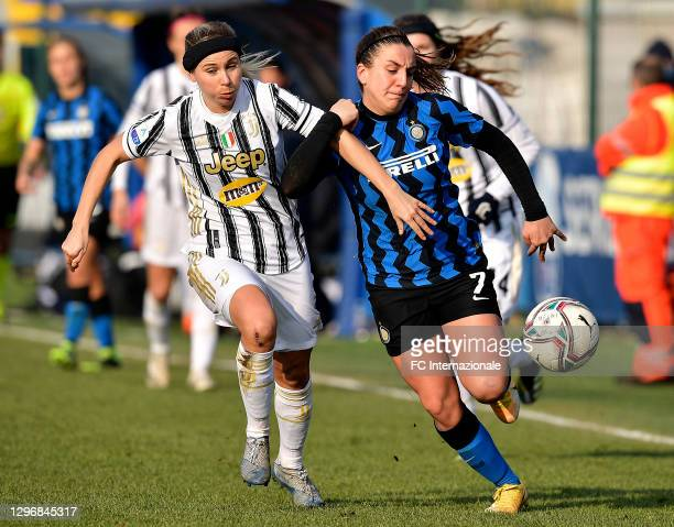 Gloria Marinelli of FC Internazionale challenges for the ball with Tuija Hyyrynen of Juventus Women during the Women Serie A match between FC...