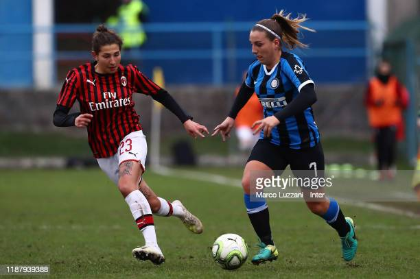 Gloria Marinelli of FC Internazionale is challenged by Miriam Longo of AC Milan during the Women Coppa Italia match between FC Internazionale v AC...