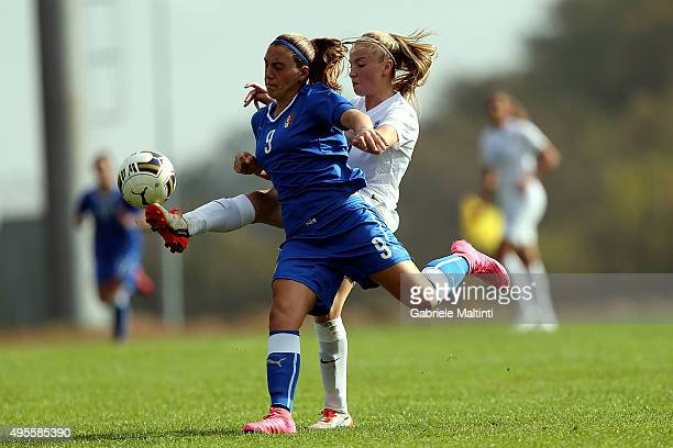 Gloria Marinelli of Italy U19 women's battles for the ball with Evie Clarke of England U19 women's during the international friendly match between...