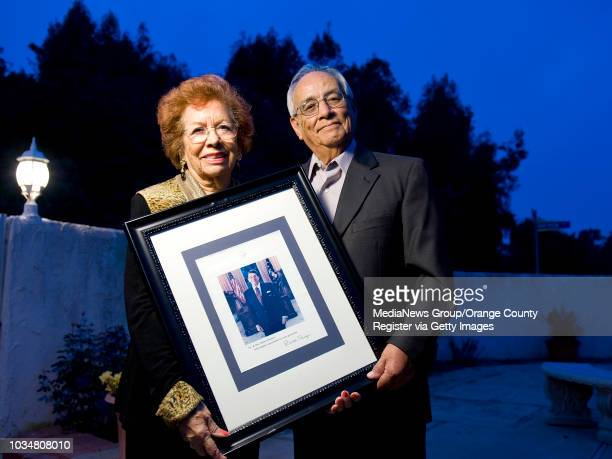 Gloria Montes and her husband Bob of Newport Beach display a signed photo given to them by President Reagan They attended the inaugurations for...