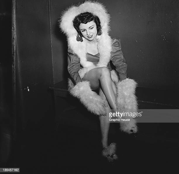 Gloria O'Malley of The Rockettes precision dance company backstage at the Radio City Music Hall in Manhattan New York City circa 1950 She is wearing...