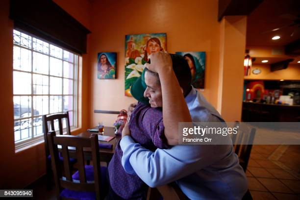 Gloria Plaza and Juan Casas right hug at the Casa Fina Restaurant Cantina in Boyle Heights September 5 2017 in Los Angeles California Both are DACA...