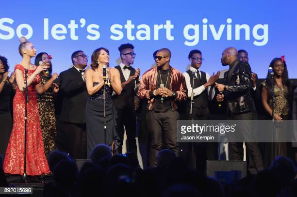 Gloria Reuben Usher and Alfre Woodard perform onstage during Robert F Kennedy Human Rights Hosts Annual Ripple Of Hope Awards Dinner on December 13...