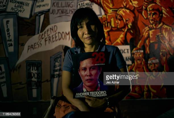 Gloria Romero Teodoro wife of slain journalist Andres Teodor joined other journalists and activists as they gather to hold a vigil on the eve of the...