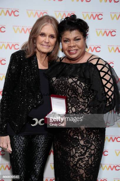 Gloria Steinem poses with journalist April Ryan holding the WMC She Persisted Award at the Women's Media Center 2017 Women's Media Awards at Capitale...