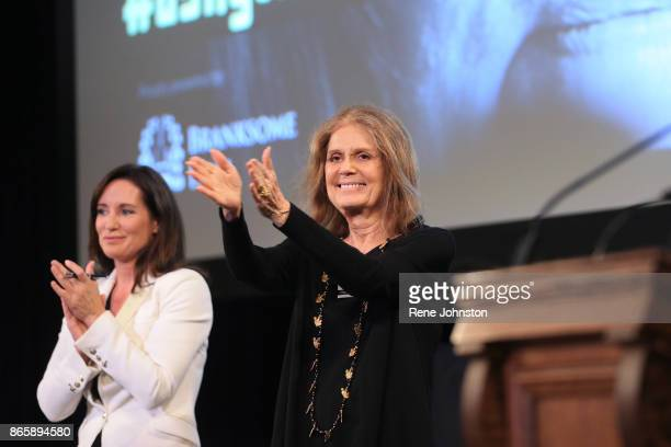 Gloria Steinem recognizes the crowd with moderator Amanda Lang as they start the event to hundreds of women at the U of T Convocation Hall