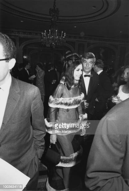 Gloria Steinem wearing 'Lady MacBeth' gown designed by Luis Estevez arriving at Shakespeare Ball with Herb Sargent