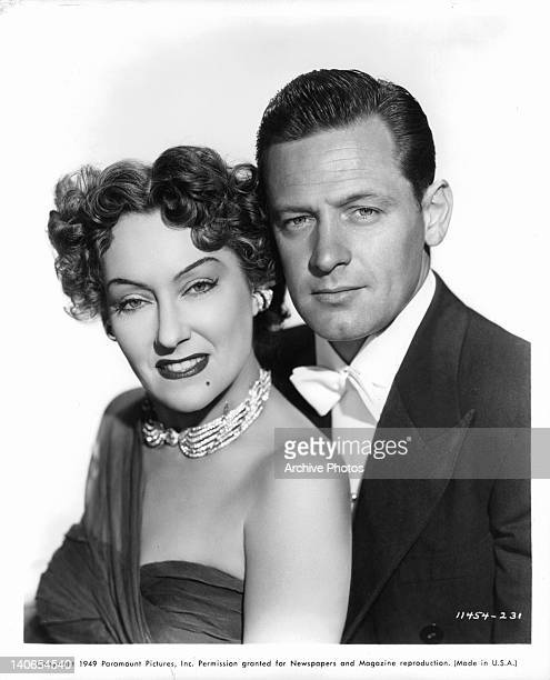 Gloria Swanson and William Holden pose in a scene from the film 'Sunset Boulevard' 1950
