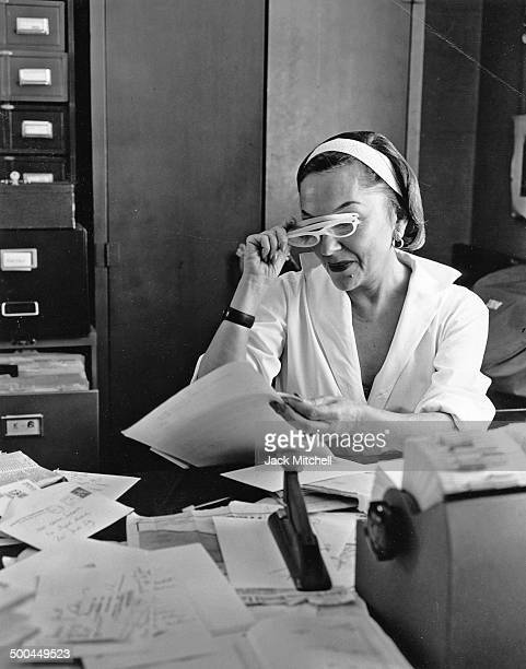 Gloria Swanson at her office at Puritan Dress Company which produced her signature women's wear line in 1960