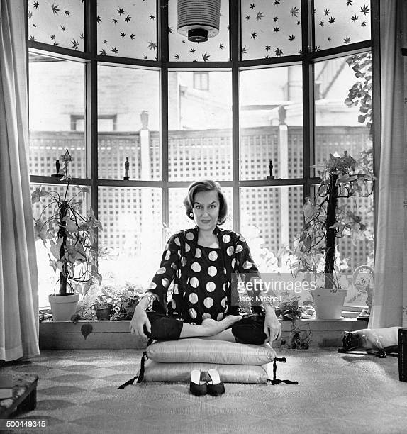 Gloria Swanson doing yoga postures in her Manhattan home 1961