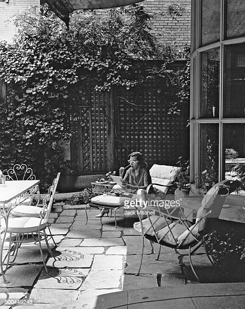 Gloria Swanson on the private patio of her Manhattan home 1960