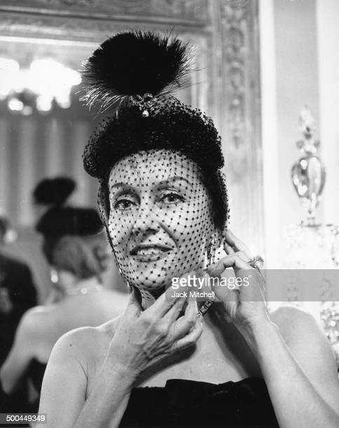 Gloria Swanson poses in the foyer of her Manhattan home in 1960