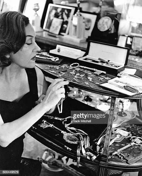 Gloria Swanson with her collection of keys to many cities she has been presented from around the world 1960