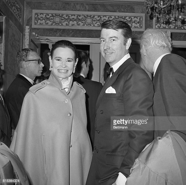 Gloria Vanderbilt and her husband Wyatt Cooper arrive at the Ethel Barrymore Theatre to attend the premier of the Broadway play 'The Seven Descents...