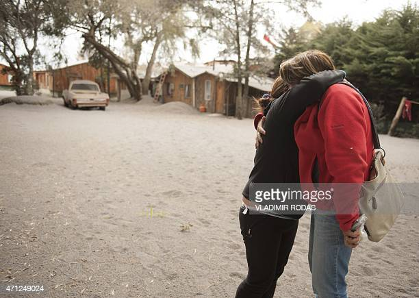 Gloria Villaroel and another woman hug each other at La Ensenada, southern Chile, on April 26, 2015. A sleeping giant for more than 50 years, Calbuco...