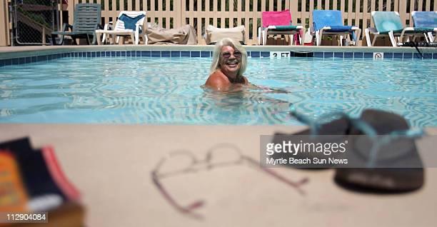 Gloria Waryas laughs as she bobs in the 84-degree pool at Whispering Pines near Ocean Isle Beach, North Carolina, June 19, 2009. The nudist resort is...