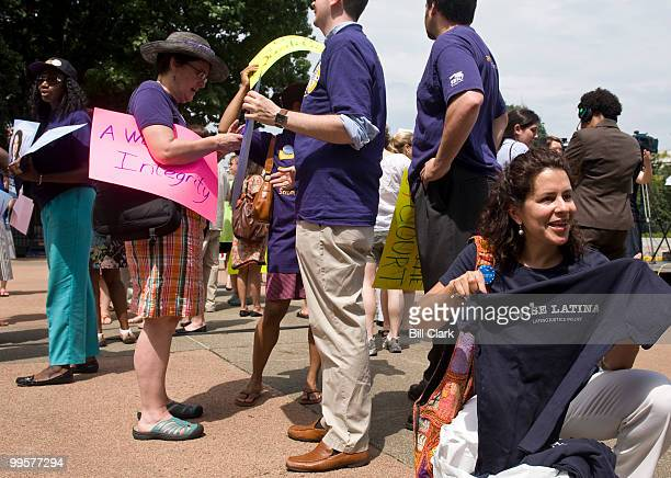 Gloria Y Rivera of the Bronx NY shows off tshirts for sale during the rally on Wednesday Aug 5 in support of the confirmation of Judge Sotomayor to...