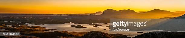 Glorious golden sunrise over Highlands wilderness mountain glen lochs Scotland