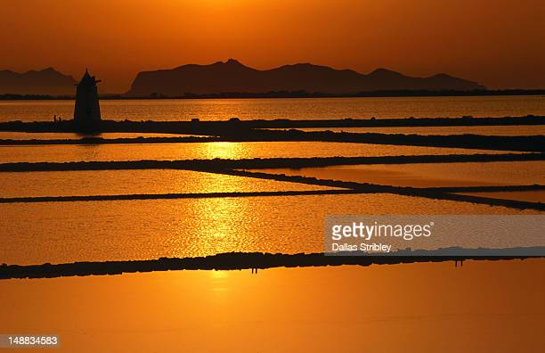 Glorious golden sunset over the salt pans on San Pantaleo, with the Egadi Islands in the distance.
