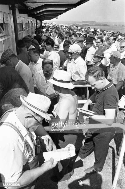 Glorious Goodwood 1963 Racegoers on The Trundle the Iron Age hill fort which is used as an informal grandstand Seen here with improvised sun hat...