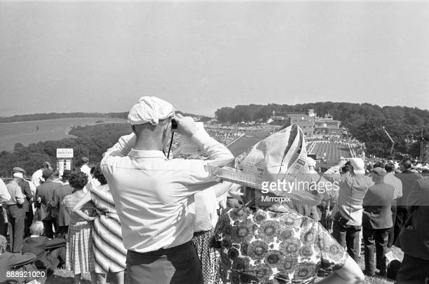 Glorious Goodwood 1963 Two racegoers on The Trundle the Iron Age hill fort which is used as an informal grandstand Seen here with improvised sun hat...