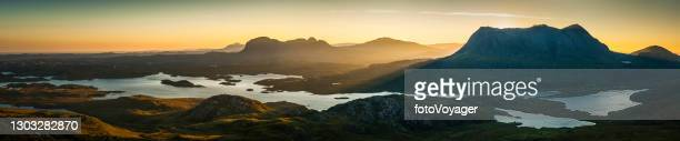 glorious mountain sunrise golden dawn peaks panorama inverpolly highlands scotland - scottish culture stock pictures, royalty-free photos & images