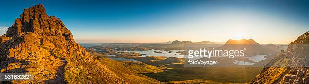 Glorious mountain sunrise golden light on idyllic wilderness Highlands Scotland