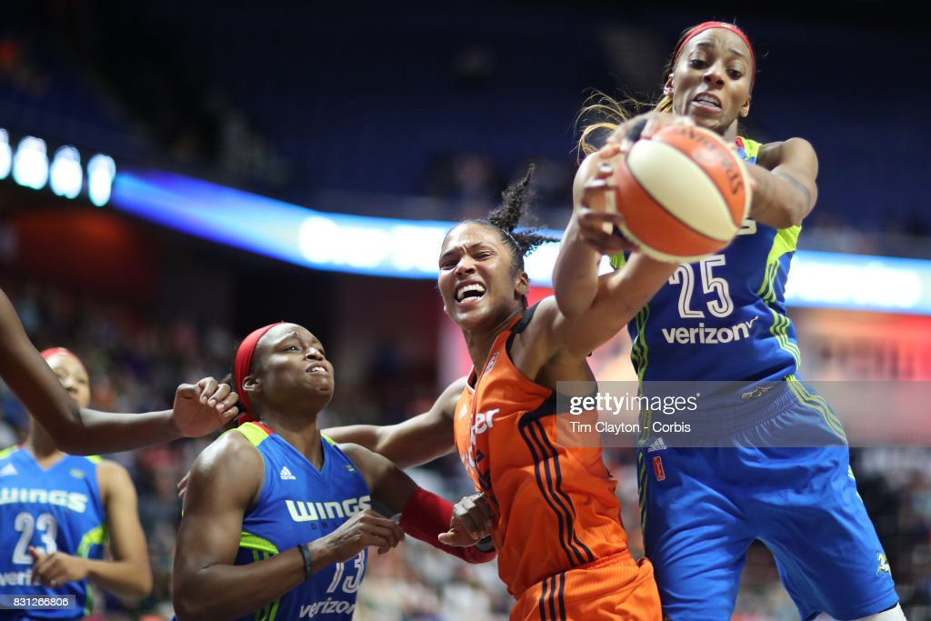 Glory Johnson #25 of the Dallas Wings and Alyssa Thomas #25 of the Connecticut Sun challenge for a rebound during the Connecticut Sun Vs Dallas Wings, WNBA regular season game at Mohegan Sun Arena on August 12th, 2017 in Uncasville, Connecticut.