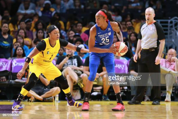 Glory Johnson of the Dallas Wings handles the ball against Odyssey Sims of the Los Angeles Sparks during a WNBA basketball game at Staples Center on...