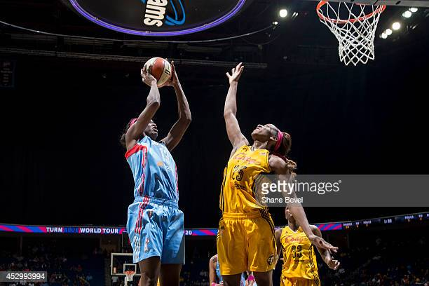 Glory Johnson of the Tulsa Shock attempts to block a shot against Aneika Henry of the Atlanta Dream during the WNBA game on July 31 2014 at the BOK...