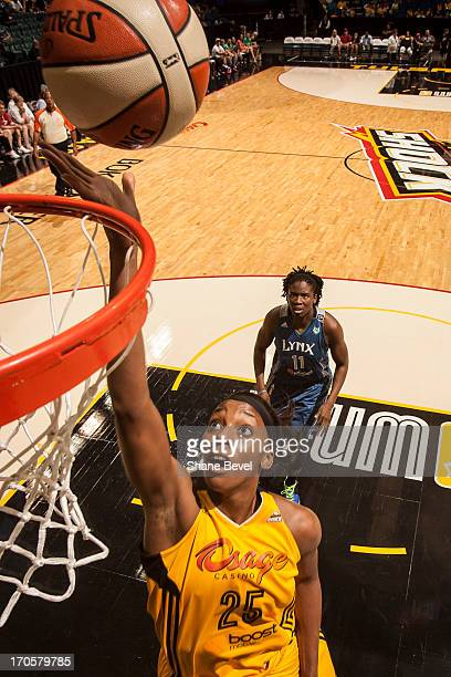 Glory Johnson of the Tulsa Shock shoots a layup after beating Amber Harris during the WNBA game on June 14 2013 at the BOK Center in Tulsa Oklahoma...