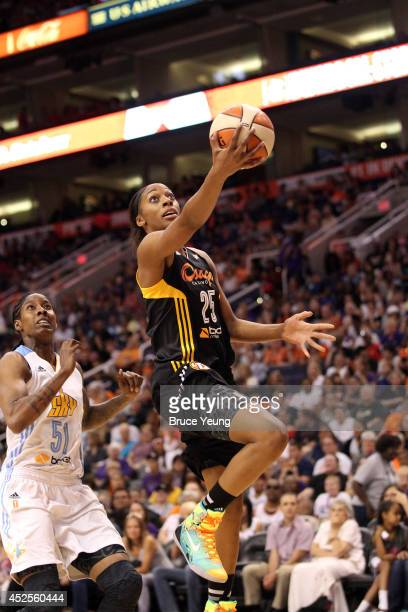 Glory Johnson of the Western Conference AllStars shoots against Jessica Breland of the Chicago Sky during the 2014 Boost Mobile WNBA AllStar Game on...