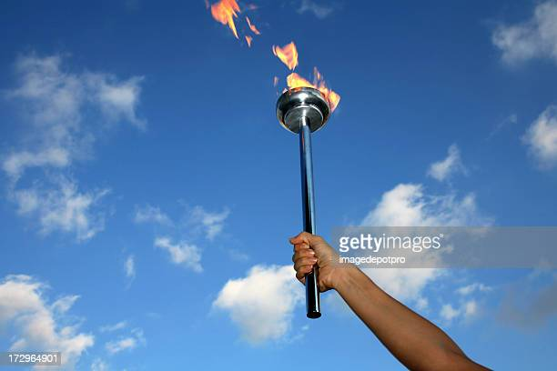 glory of holding flaming torch - flame stock pictures, royalty-free photos & images