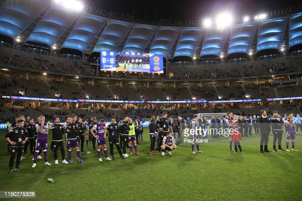 Glory players and staff look as medals are presented to Sydney during the 2019 A-League Grand Final match between the Perth Glory and Sydney FC at...