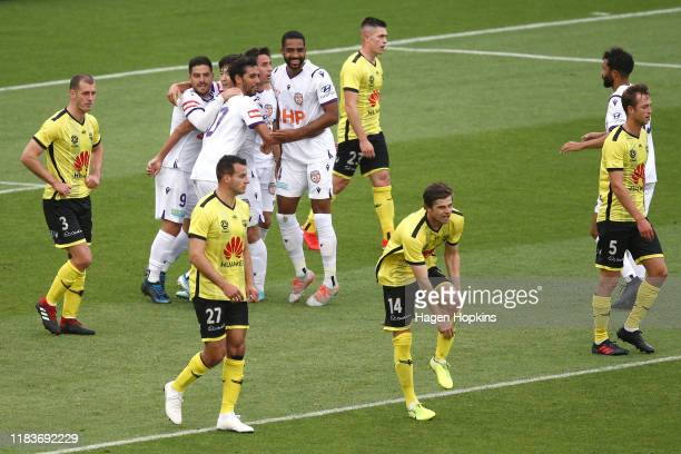 Glory players celebrate their second goal during the round three ALeague match between the Wellington Phoenix and the Perth Glory at Westpac Stadium...