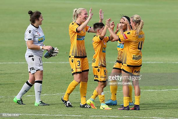 Glory players celebrate victory at the end of the round 14 WLeague match between the Western Sydney Wanderers and Perth Glory at Popondetta Park on...