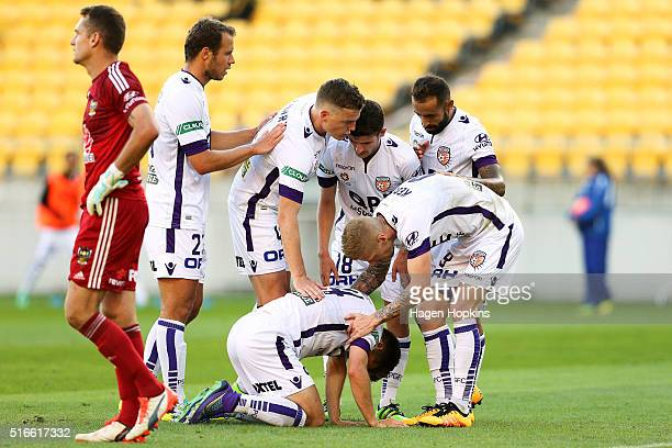 Glory players check on the health of Chris Harold while celebrating the goal of Diego Castro during the round 24 ALeague match between the Wellington...