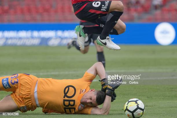 Glory's Liam Reddy slides under Marcelo Carrusca of the Wanderers during the round 23 ALeague match between the Western Sydney Wanderers and Perth...