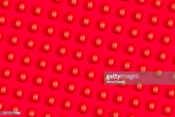 glossy orange egg on trendy coral background. - osterfeuer stock-fotos und bilder