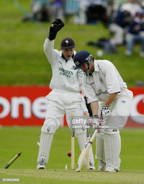 Gloucester batsman Alex Gidman looses his wicket to Kent's Darren Stevens watched by wicketkeeper Niall O'Brien