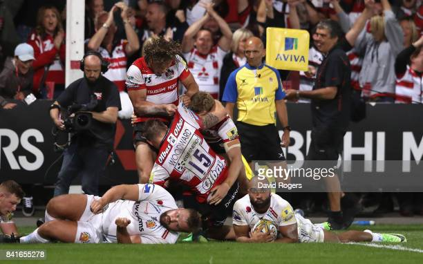 Gloucester celebrate after Jason Woodward scores the last minute match winning try during the Aviva Premiership match between Gloucester Rugby and...