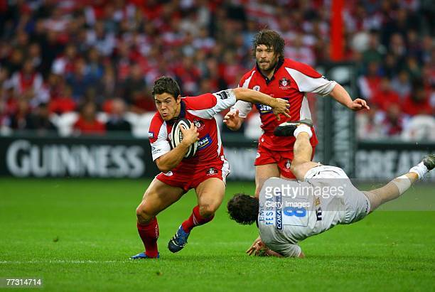 Gloucester centre Anthony Allen bursts past the challenge of Genaro Fessia during the Guinness Premiership game between Gloucester and Sale Sharks at...