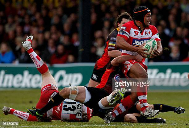 Gloucester centre Eliota Fuimaono-Sapolu breaks a tackle to set up the first Gloucester try during the Heineken Cup Pool 2, Round 6 match between...