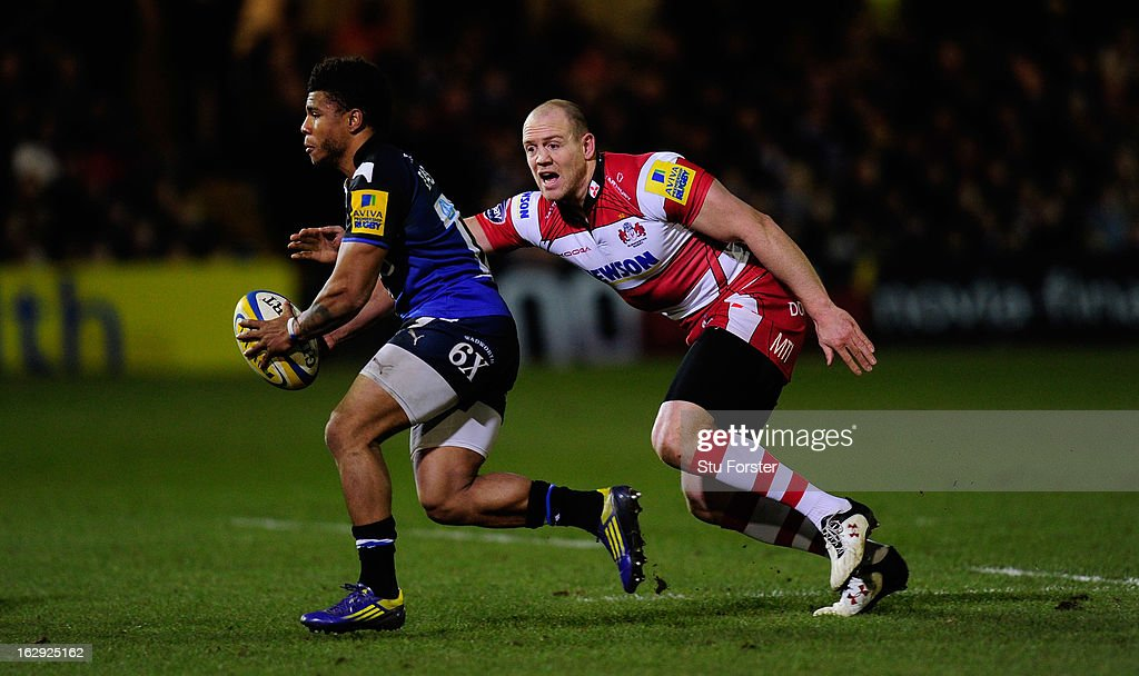 Gloucester centre Mike Tindall can only watch as Bath centre Kyle Eastmond runs past him during the Aviva Premiership match between Bath and Gloucester at Recreation Ground on March 1, 2013 in Bath, England.