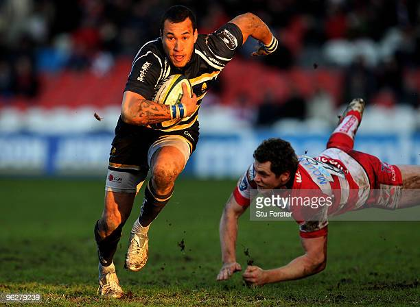 Gloucester centre Tim Molenaar dives in vain to stop Warriors winger Rico Gear during the LV Anglo Welsh Cup match between Gloucester and Worcester...