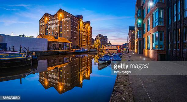 gloucester docks national waterways museum redeveloped warehouses illuminated sunset panorama - gloucester england stock pictures, royalty-free photos & images