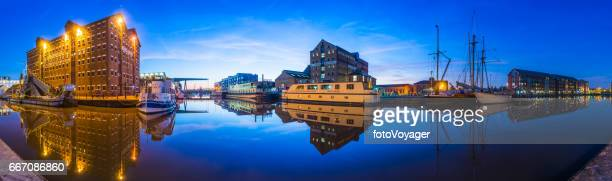 Gloucester Docks National Waterways Museum warehouses boatyards panorama illuminated sunset