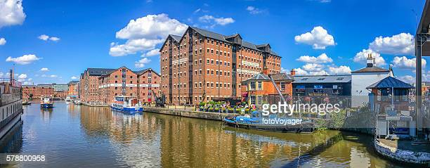 gloucester docks people enjoying summer sunshine pubs waterfront warehouses boats - gloucester england stock pictures, royalty-free photos & images