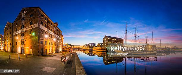 Gloucester Docks redeveloped warehouses boatyard sailing ships canal sunset panorama